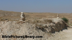 Typical Boundary Markers. Such markers were specifically protected under the Law of Moses (Dt 19:14; Prov 22:28) In fact Dt 27:17 tells us, 'Cursed is the one who moves his neighbor's landmark.' Job (24:2) shows us that this has been understood as theft since ancient times. Babylonian, Egyptian, Greek & Roman law also viewed such moving of these boundary stones as a crime. THose who refuse to live righteously are described in Hosea 5:10 as 'like those who remove a landmark'.